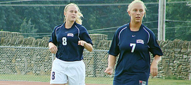 Christine Janssens, left, and Haley Oborny are among the top returners for the Wildcat women's soccer team. The Baker soccer teams open on Aug. 27 against Southern Nazarene.