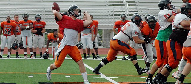 Baker University freshman Zach Faust, center, is one of two possible players that will be starting at quarterback for the Wildcats on Saturday at Ottawa University.