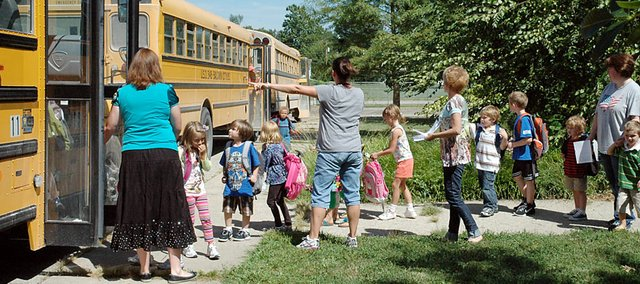 Students at Baldwin Elementary School Primary Center board the bus after the first day of class last week. They'll be going to the new BESPC starting Tuesday, which is earlier than expected.