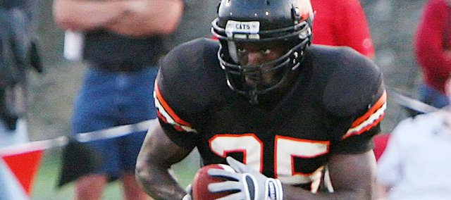 John Babb, of Topeka, is expected to be one of Baker's featured running backs. Wildcat football coach Mike Grossner plans on Babb and five other players to share the rushing load to replace Richie Bryant.