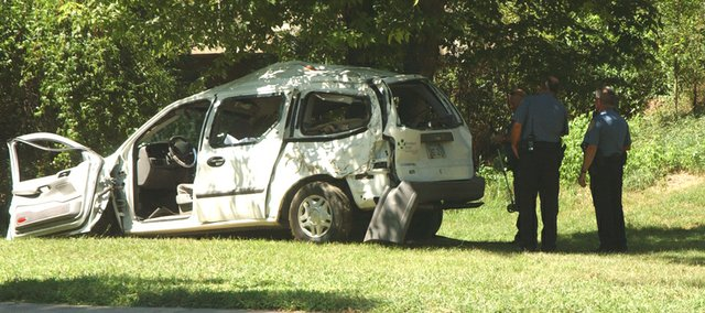 Tonganoxie police officers investigate an accident early Friday afternoon in VFW Park.