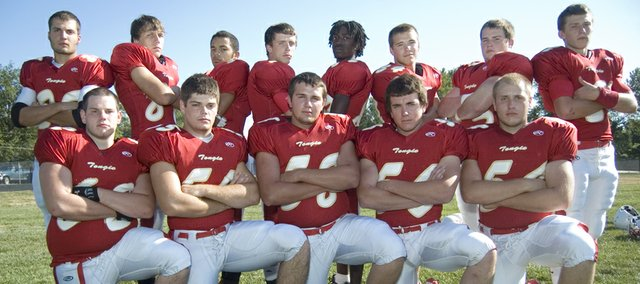 Tonganoxie High football seniors (front row) Justin Francis, Lucas Ahart, AJ Gilbert, Jacob Cannon, Dylan Fosdick, (back row) Dylan Scates, Austin Vickers, Shawn Marin, Jeremy Carlisle, Adrian Whittington, Ian McClellan, Tucker Hollingsworth and Jeff Sims remember last years four narrow losses and lead the Chieftains as they start their 2010 season at 7 p.m. Friday against Bishop Ward.