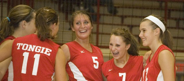 The Tonganoxie High volleyball team had plenty to smile about in an easy home victory over Atchison Tuesday night. Such was the case when Danielle Miller, Haley Smith, Molly O'Hagan, Hannah Kemp and Kailan Kuzmic came together to celebrate a point in the first game.