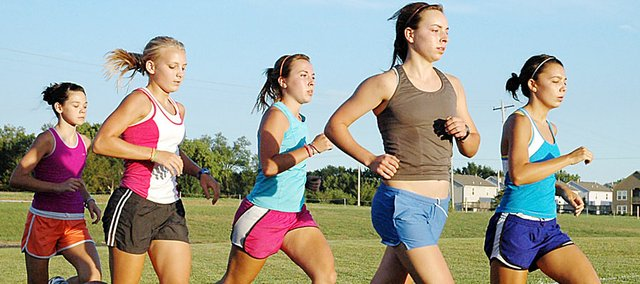 Baldwin High School's cross country teams ran a workout at the new track recently. The girls pictured, from left, are freshman Hannah Hutton, junior Elizabeth Sigvaldson, junior Abi Hartzell, sophomore Kaitlyn Barnes and sophomore Sienna Durr.