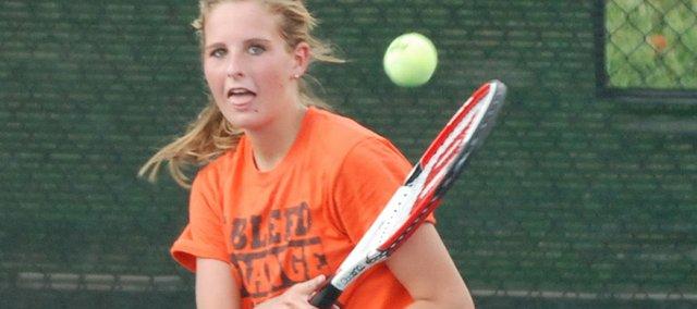 Bonner Springs' Hannah Hunt follows through on a backhand return during a singles match against Bishop Miege.