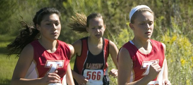 Although the Tonganoxie High girls lost their season-opening cross country dual with Lansing Friday afternoon, Alex Hauk and Emily Soetaert won medals as Hauk placed fourth and Soetaert took third.