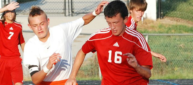 Tonganoxie's Tyler Bartholomew tracks down the ball during the Chieftains' 4-0 loss at Bonner Springs.