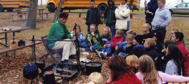 Jim Stanley, Bonner Springs, speaks with a group of students while participating in a Lewis and Clark expedition re-enactment.