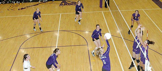 Baldwin High School freshman Morgan Lober spikes a ball Tuesday night at Spring Hill. BHS lost the match in three games.