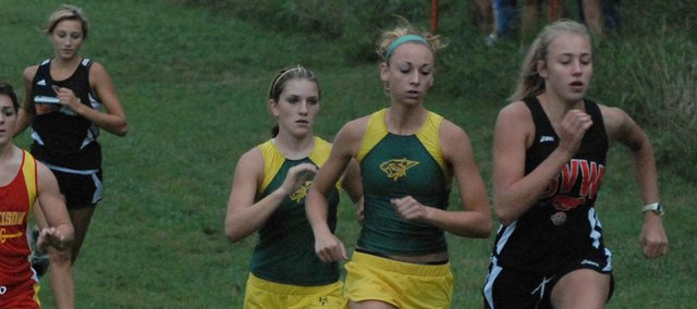 Basehor-Linwood cross country runners Hannah Tush, second from right, and Ally Laney, third from right, were among the early leaders of the pack on Thursday at the Bobcat Invitational. Laney placed second overall and Tush finished fifth while leading BLHS to a team championship.