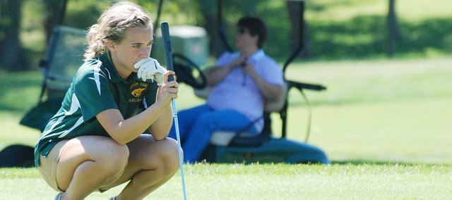 Basehor-Linwood's Marissa Dove lines up a putt during the Piper Invitational.