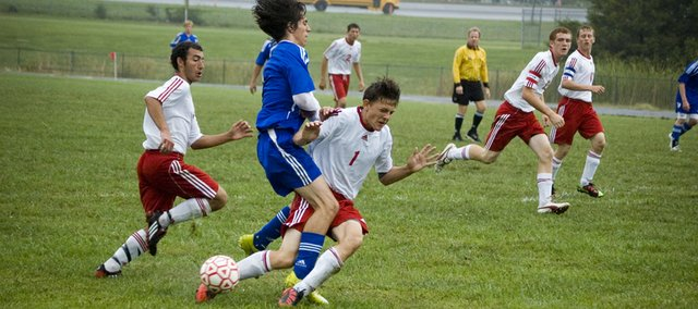 Marcus Titterington collides with a Perry-Lecompton forward in the first half of Tonganoxie High's 1-0 home victory on Thursday.