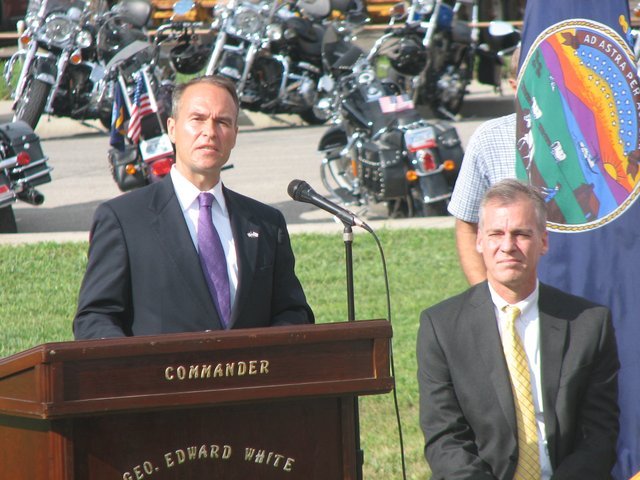 Kansas Attorney General Steve Six addresses the crowd at a 9/11 remembrance ceremony in at Leavenworth's VFW Park on Saturday morning, as Governor Mark Parkinson watches on.