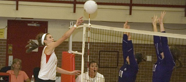 Kailan Kuzmic tips the ball over the net in Tonganoxie's home loss to Baldwin on Thursday.