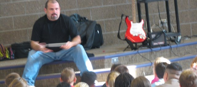 Kevin Honeycutt, an Internet safety speaker from Central Kansas, speaks Monday with students from Basehor-Linwood Middle School. Honeycutt cautioned students to be careful with what they post on the Internet.
