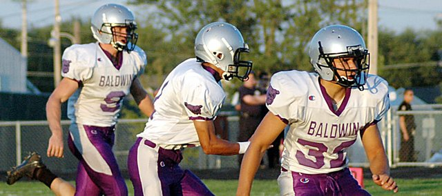 Baldwin High School junior Asher Hannon, center, returns the opening kick off Friday. Hannon intercepted a De Soto pass and returned it 75 yards for the Bulldogs' final touchdown. Baldwin beat De Soto 21-7.
