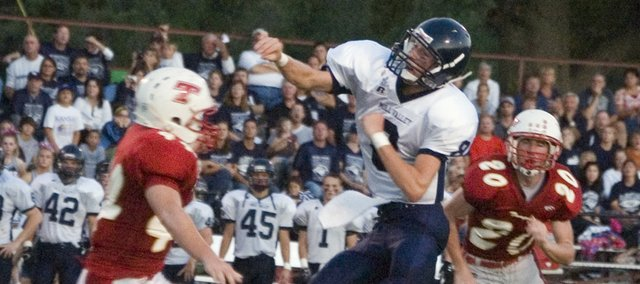 Mill Valley High quarterback Skyler Windmiller throws for one of his five touchdown passes against Tonganoxie on Friday night at Beatty Field. The Jaguars walloped the Chieftains, 57-12.