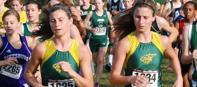 Basehor-Linwood's Sheridan Miles, left, and Shelby Miles compete during the Bonner Springs Invitational at Wyandotte County Park.