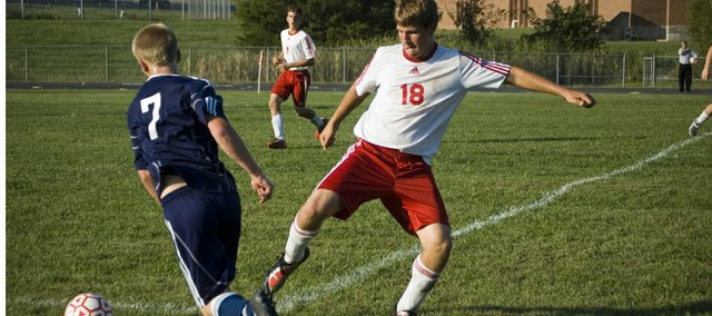 Tonganoxie High freshman defender Ben Edmonds tries to stop a Mill Valley attack on Monday afternoon. The Chieftains lost their home match against Mill Valley, 2-1.