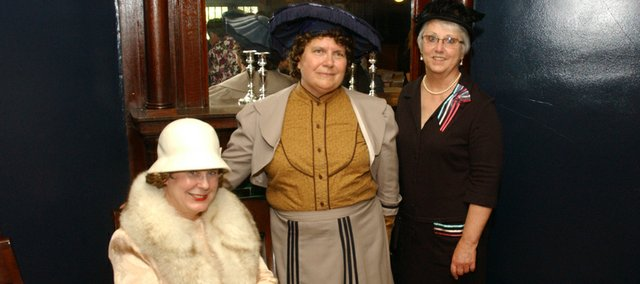 In costume and in character, First City Performers and StoryTellers Keyta Kelly, Laura Elkins and Kathy Peak pose inside the Myers Hotel. The three women will protray Leavenworth County historical figures Hilda Clark, Carrie Hall and Mollie Myers at presentation at 7 p.m. Tuesday at the Tonganoxie Community Historical Site, 201 W. Washington St.