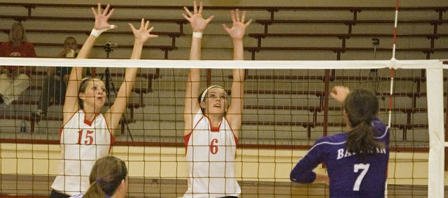 Brooklyn Kerbaugh and Kailan Kuzmic go up for a block attempt in this Mirror file photo. The Tonganoxie High volleyball team took second place at the Rossville Invitational on Saturday, going 5-1 at the tournament.