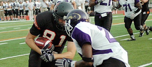 Baker University's Jesse Green (No. 81) hits an Avila player after scoring a touchdown Saturday. Green, a 2008 Baldwin High School graduate, caught his first-ever touchdown for the Wildcats on a pass from quarterback Jake Morse.