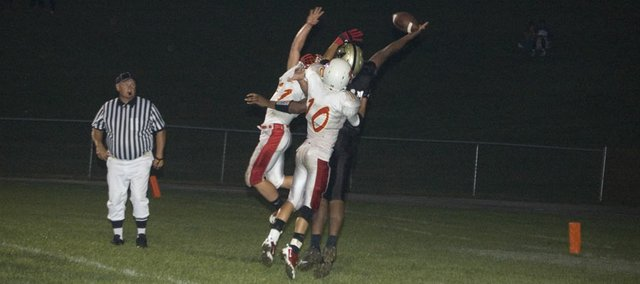 Tonganoxie High's Joe Wolfe (11) and Adam Thomas (10) attempt to defend a pass on a two-point conversion attempt by Turner on Friday at Kansas City, Kan. Turner defeated the Chieftains, 28-8.
