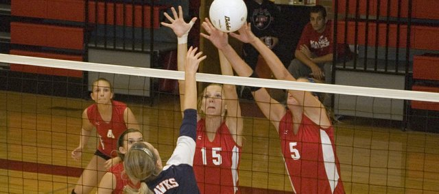 Brooklyn Kerbaugh and Molly O'Hagan go up for a block in Tonganoxie High's victory over Olathe East Saturday afternoon at the Tonganoxie Invitational. The Chieftains finished fourth at the tournament with a 3-3 record.
