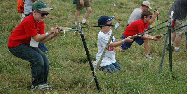 Cub Scouts try to catapult balls at a target Saturday during the Heart of America Council, Boy Scouts of America Centennial Campout. The campout, located across the street from the Theodore Naish Scout Reservation, drew 11,000 Scouts.