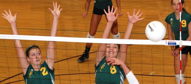 Basehor-Linwood's Cara McCarty (2) and Courtney Poe (8) attempt to block a shot during the Bobcats' semifinal match at the Louisburg Tournament.