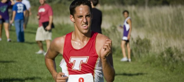 Caleb Himpel finishes up his 12th-place run on Sept. 21 at the Tonganoxie Invitational.  The Tonganoxie High boys finished third in the team standings.