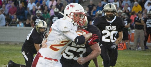 Dylan Scates tries to evade a Turner High linebacker in the first quarter of Tonganoxie's 28-8 loss at Kansas City, Kan., on Friday. Scates injured his left shoulder later in the quarter and had to leave the game, thinning the Chieftains' roster.