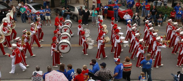 Tonganoxie High School Marching Band members march Saturday along Massachusetts Street in downtown Lawrence as part of Kansas University Band Day. The THS band, as well as the McLouth High band, participated in the parade, as well as the halftime show of Saturday's Kansas-New Mexico State football game in Memorial Stadium.