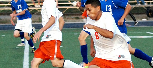 Bonner Springs forward Jose Lopez blows past a Gardner-Edgerton player while making a run at the goal. Lopez scored two goals during the first 13 minutes in the Braves' 4-1 victory.