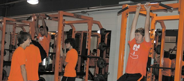 A group of students works out in the new weight room at Bonner Springs High School. School officials say the room, which was partially funded through donations, was needed to allow for more effective use of workout and training time. The first phase was completed earlier this month.