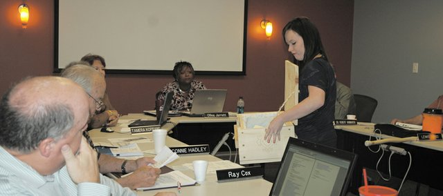 Bonner Springs High School senior Jessica Johnson tells school board members about her senior project, in which she and several students built 20 infant caskets to donate to parents who have lost their children.