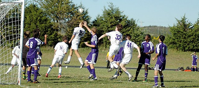 Baldwin High School soccer players compete for a corner kick Tuesday. BHS lost to Spring Hill, 4-1, after the Broncos scored two late goals.