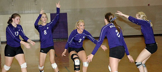 Members of the Baldwin High School volleyball team celebrate winning a point Tuesday. Pictured, from left, are sophomore Katie Kehl, freshman Morgan Lober, senior Claire Glover, senior Ramie Burkhart and junior Lakyn Clark.