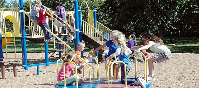 Marion Springs Elementary School students enjoy time on the playground Tuesday afternoon.