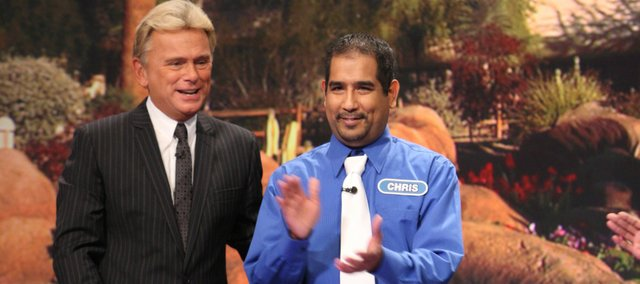 "Chris Albert chats with game show host Pat Sajak during a taping of ""Wheel of Fortune."""