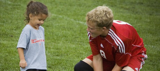 Cori Morman gets some guidance from her coach, Tonganoxie High sophomore Conner Kietzmann, at a practice on Sept. 23. Five THS soccer players are coaching teams for the Tonganoxie Recreation Commission's youth leagues.