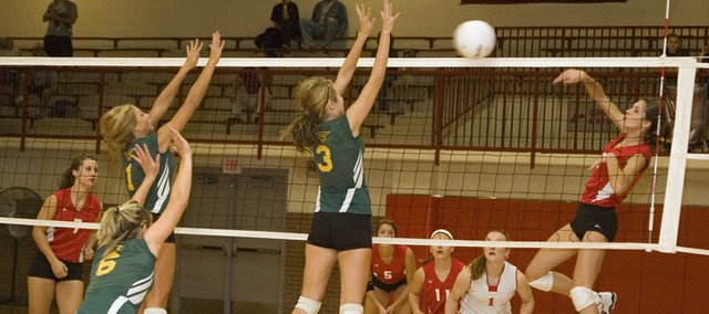 Jenny Whitledge spikes the ball over the net against Basehor-Linwood during Tonganoxie High's win in a home daul on Tuesday night.
