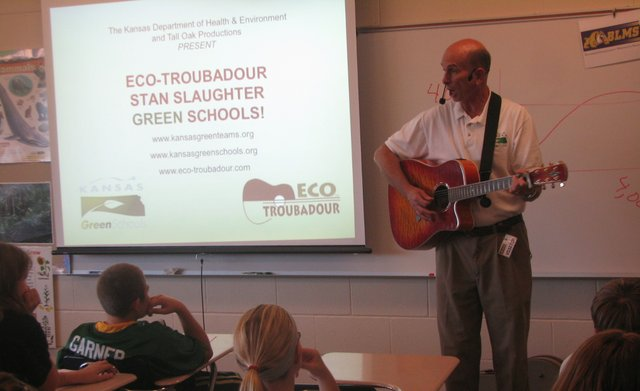 "Stan Slaughter, an ""Eco-Troubadour,"" sings the 1969 song ""Garbage"" by Bill Steele — with a few modern alterations — to Basehor-Linwood Middle School sixth-graders on Friday."