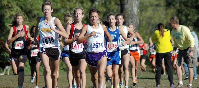 Baldwin High School sophomore Sienna Durr, center, leads the 4-kilometer race Saturday. Durr finished second as both BHS teams also finished runner-up to the No. 1-ranked Class 6A teams.
