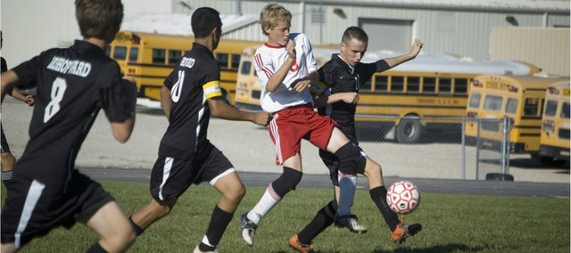Tonganoxie High's Conner Kietzmann tries to win the ball from a Bishop Ward defender in the first half of the Chieftains' 8-1 home loss on Thursday.