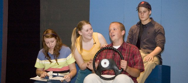 "Tonganoxie High School students rehearse Monday for the play ""Leaving Iowa."" Pictured are, from left, Megan Woods, Lacie Falk, Elliot Brest and Michael Christensen."