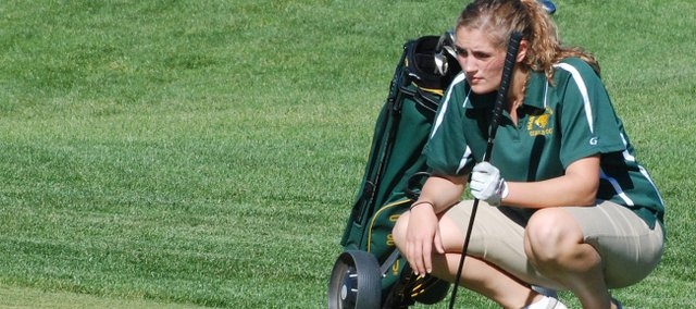 Basehor-Linwood's Rachel VanFleet lines up a putt on No. 3 at Falcon Lakes during the Basehor-Linwood Invitational.