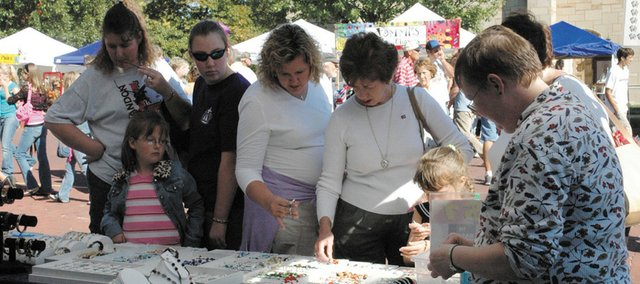 Visitors to the Maple Leaf Festival can purchase  handmade arts and crafts from the many booths that line Eighth and High streets in Baldwin City. The annual festival is this weekend.