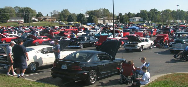 Cars, trucks, motorcycles and lawn chairs pack the Basehor-Linwood High School parking lot Saturday for the 13th annual Basehor Car Show. The event, a fundraiser for the high school's Project Graduation, drew a record crowd of 488 entrants.