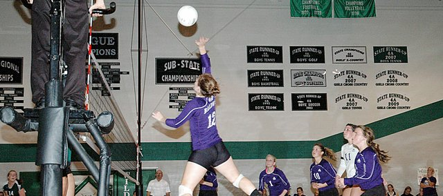 Baldwin High School sophomore Katie Kehl tips a ball over the net Tuesday at De Soto. Baldwin lost to the Wildcats in five games, after winning the first two games.